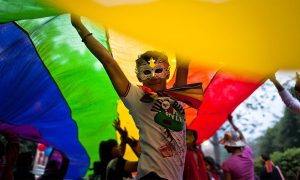 A boy dances as he and others participate during the 4th Delhi Queer Pride