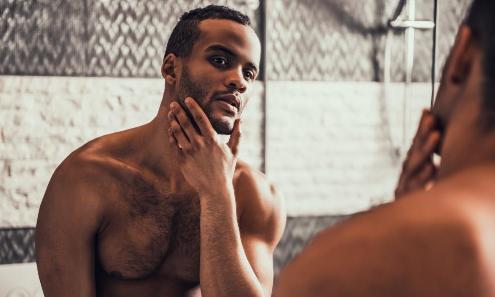 Black man looking in the mirror