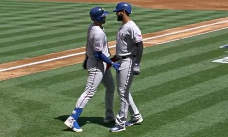 Baseball Players Celebrate Home Run With Frisky Handshake