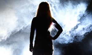 """Singer Britney Spears is silhouetted as she attends the announcement of her new residency, """"Britney: Domination"""" at Park MGM on October 18, 2018 in Las Vegas, Nevada. Spears will perform 32 shows at Park Theater at Park MGM starting in February 2019. (Photo by Ethan Miller/Getty Images)"""