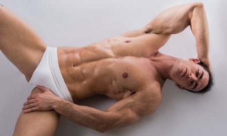 Man laying down in his underwear